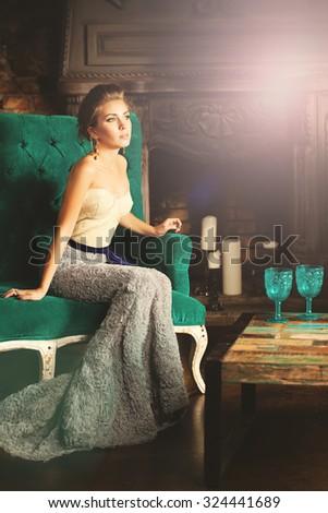 Elegant Woman in Retro Palace Interior - stock photo
