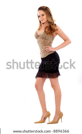 elegant woman standing wearing a mini skirt and stiletto heels
