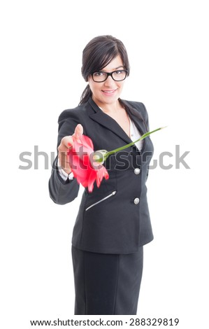 Elegant woman throwing a flower to the camera. Romantic female concept - stock photo
