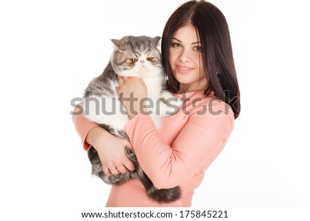 elegant woman wearing grey felt hat in retro style holding cat .Glance of woman and cat is the same. Resembling, similarity. - stock photo