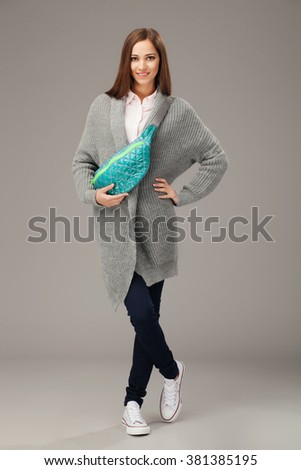 Elegant woman with a fanny pack  - stock photo