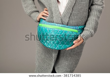 Elegant woman with a fanny pack. Closeup picture