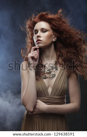 elegant woman with bright red curly hair - stock photo