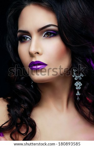 Elegant woman with curly hair and purple lips