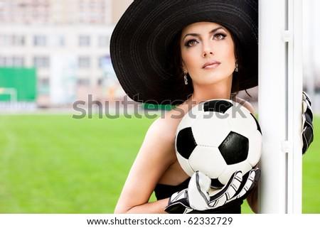 Elegant woman with Football ball - stock photo