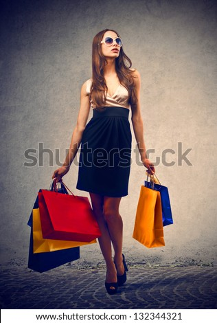 elegant woman with many shopping bags - stock photo