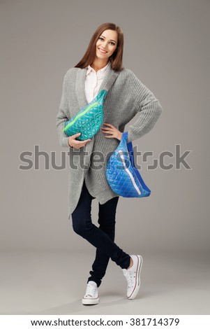 Elegant woman with two fanny packs