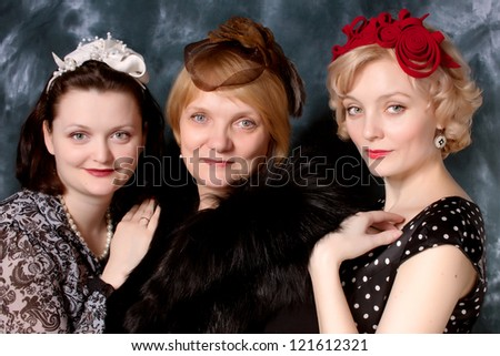 elegant women mother and daughters wearing grey felt hat in retro stlyle - stock photo