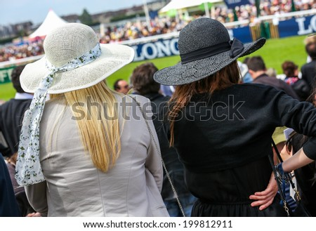 elegant women with their beautiful hats  - stock photo