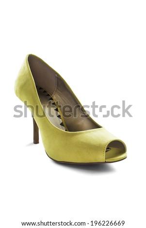 Elegant yellow textile high heeled shoe on white background - stock photo
