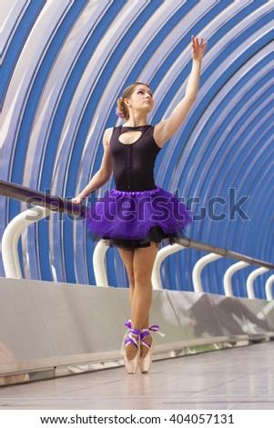 elegant young ballerina dancing in the street - stock photo
