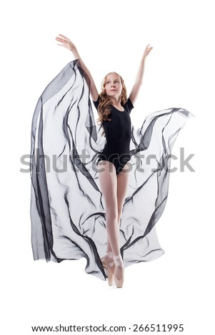 Elegant young ballerina dancing with cloth - stock photo