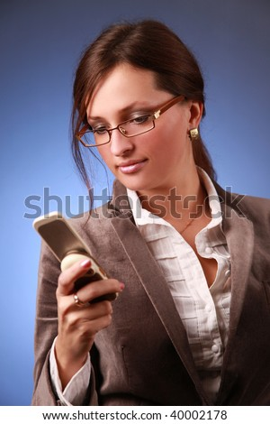 elegant young business woman calling phone