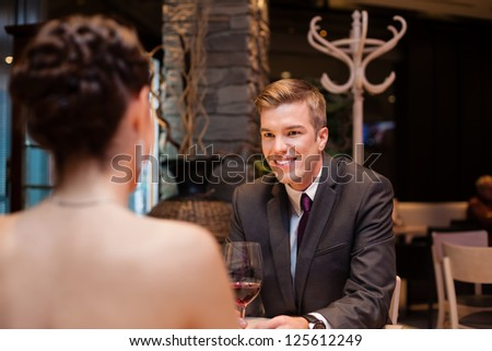 elegant young couple at the restaurant - stock photo