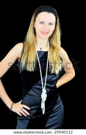Elegant young girl, isolated on black - stock photo