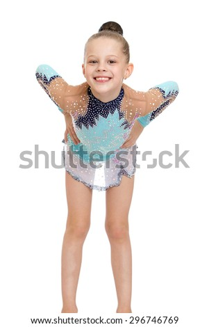 Elegant young gymnast in a beautiful sports dress bent over in front of the camera and smiling , close-up-Isolated on white - stock photo