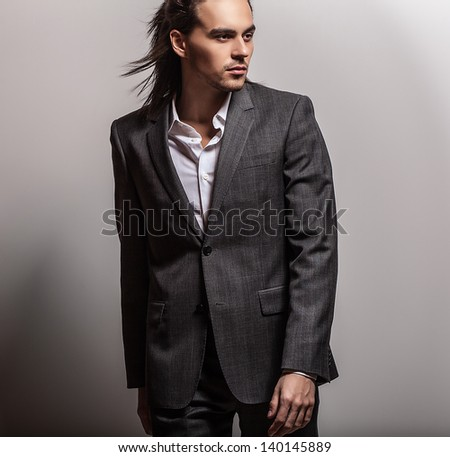 Elegant young handsome long-haired man. Studio fashion portrait. Elegant young handsome long-haired man. Studio fashion portrait.