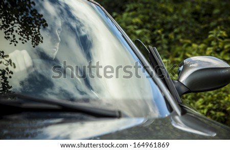 Elegant young handsome man and convertible car. Outdoor photo.  - stock photo