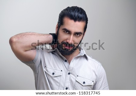Elegant young handsome man fashion portrait - stock photo