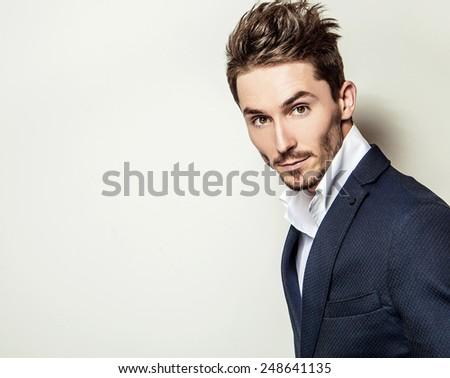 Elegant young handsome man in classic costume. Studio fashion portrait. - stock photo