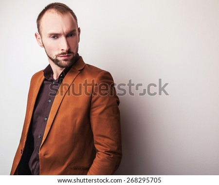 Elegant young handsome man in classic costume. Studio fashion portrait.