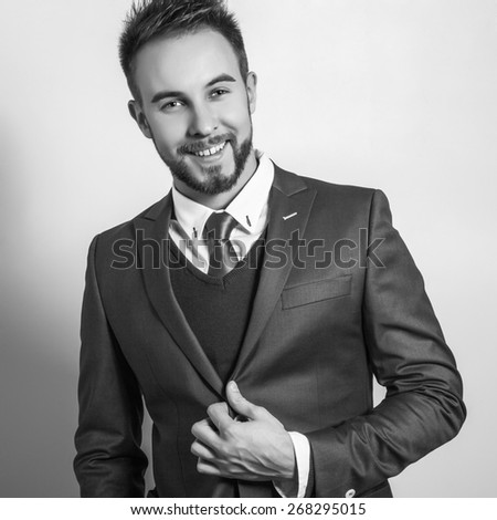 Elegant young handsome man in costume. Black-white studio fashion portrait.  - stock photo