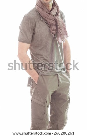 Elegant young handsome man in gray clothing. Studio fashion portrait. - stock photo