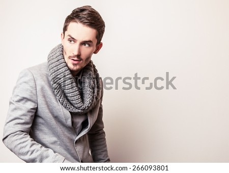 Elegant young handsome man in grey costume. Studio fashion portrait. - stock photo