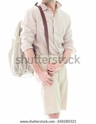 Elegant young handsome man  in white clothing. Studio fashion portrait. - stock photo