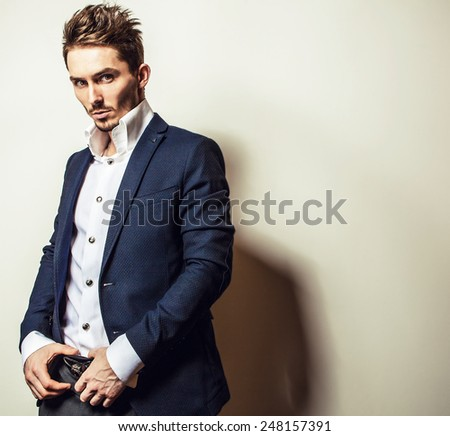 Elegant young handsome man in white shirt. Studio fashion portrait.