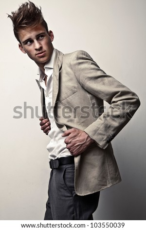 Elegant young handsome man. Studio fashion portrait. - stock photo