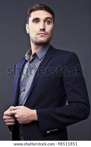 Elegant young handsome man. Studio fashion portrait. - stock photo