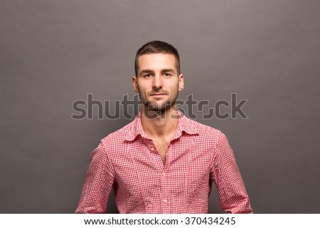 Elegant young handsome man. Studio fashion portrait. Portrait of model man in studio. - stock photo