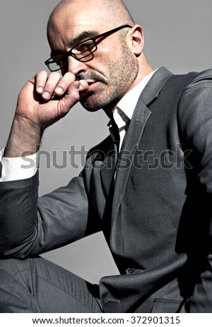 Elegant young handsome man wearing glasses. Studio fashion portrait. - stock photo