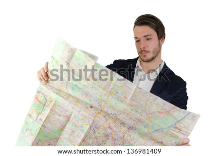 Elegant young man confused, lost and puzzled reading city map - stock photo