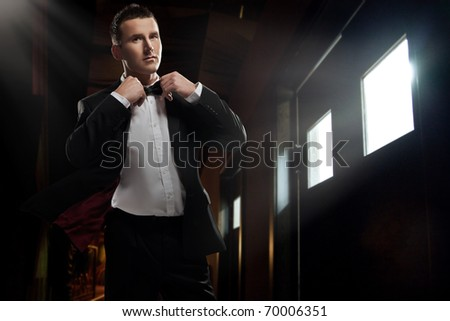 Elegant young  man walking - stock photo