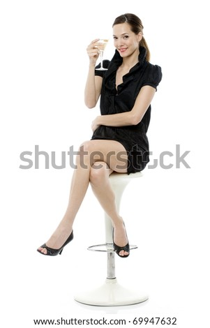 elegant young woman drinking a cocktail on white background studio