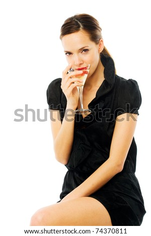 elegant young woman drinking a cocktail on white background studio - stock photo