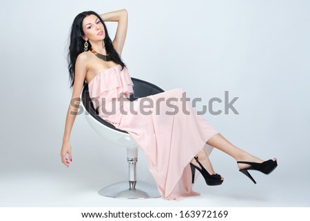 Elegant young woman in evening dress