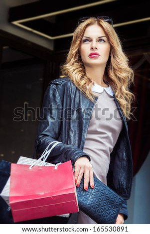 elegant young woman with shopping bags - stock photo