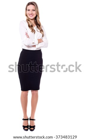 Elegantly dressed business woman posing with crossed arms - stock photo