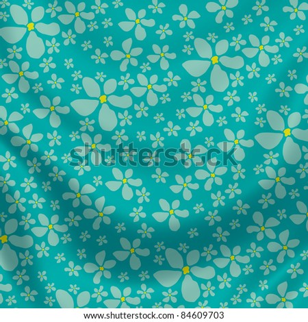 Elegantly flowing satin fabric with little flowers in blue, green, yellow - stock photo