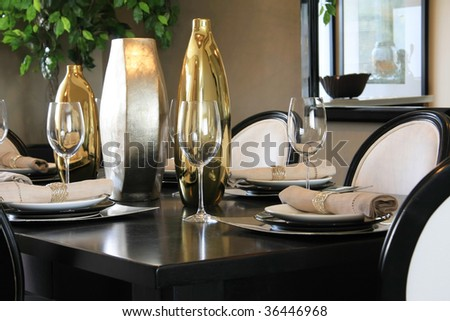 Elegantly set dining room table. - stock photo