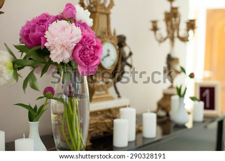 elegantly stylish conceptual creative tastefully decorated restaurant with pink peonies and ornaments for wedding