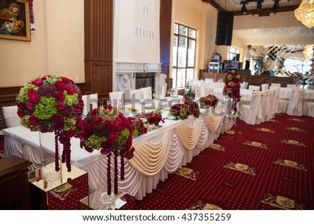elegantly stylishly luxuriantly decorated with beautifully flowers restaurant for celebration - stock photo