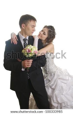 Elegantnye newly-married couple on the isolated white background - stock photo