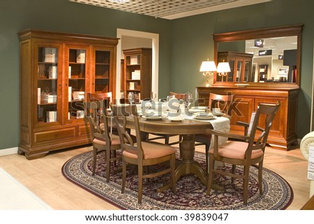 Elegnat dining room with wooden furniture. - stock photo