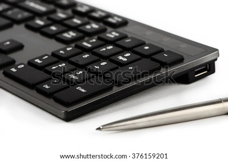 Element of black keyboard with white letters and pen - stock photo