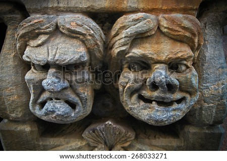 Element of building with tragedy and comedy masks in Helsinki, Finland - stock photo