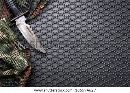 Element of military background on black grid steel. - stock photo